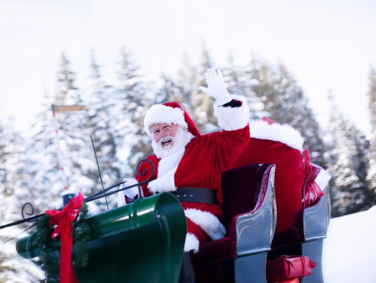 #stock Cheerful Santa Claus Waving from Sleigh in Snow