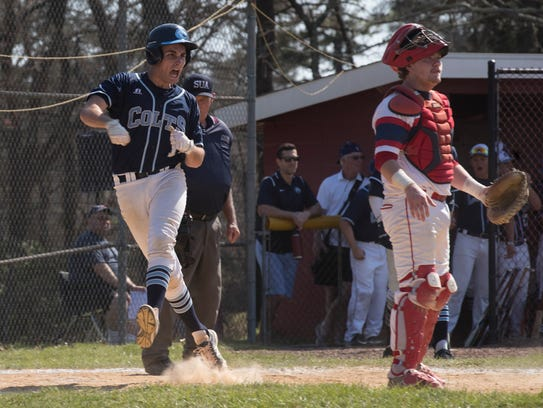 CBA's Andrea Dalatri celebrates as he crosses the plate