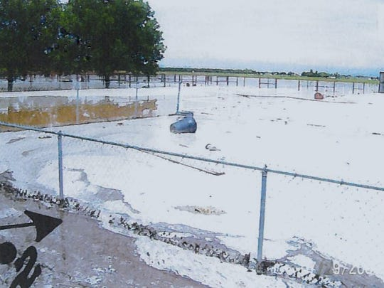 A photo filed by Clint residents in a civil lawsuit against the city of El Paso shows damage to area homes after the Clint Landfill flooded in 2006.
