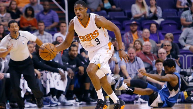 Phoenix Suns guard Brandon Knight (3) steals the ball from Minnesota Timberwolves guard Andrew Wiggins (22) during the first half of their NBA game Sunday, March 14, 2016 in Phoenix, Ariz.