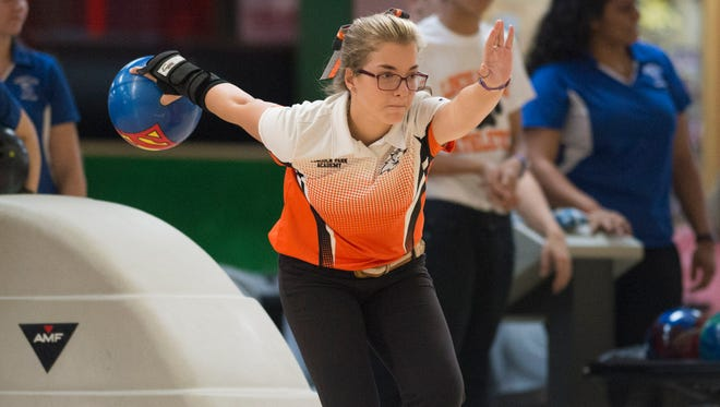 Lincoln Park Academy's Emilie Passanante bowls during the season-opening bowling match against Sebring at the Saint Lucie Lanes on Monday, August 21, 2017, in Port St. Lucie.