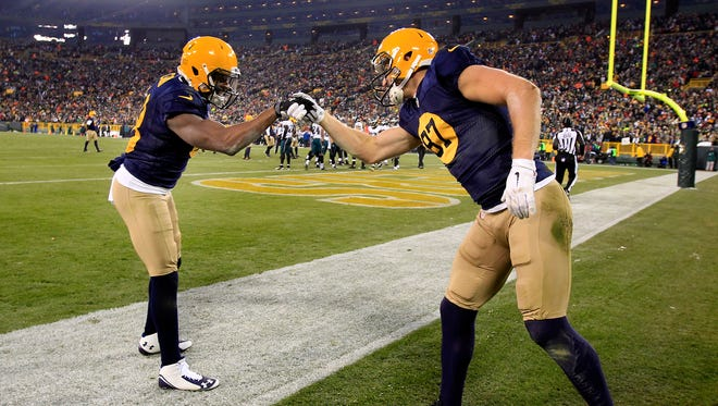 Green Bay Packers receivers Jordy Nelson and Randall Cobb celebrate a Packers touchdown.