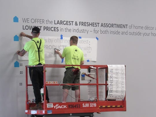 Inside signage is completed by workers.