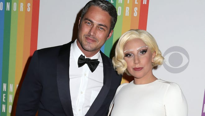 Taylor Kinney and Lady Gaga attend the 37th Annual Kennedy Center Honors.