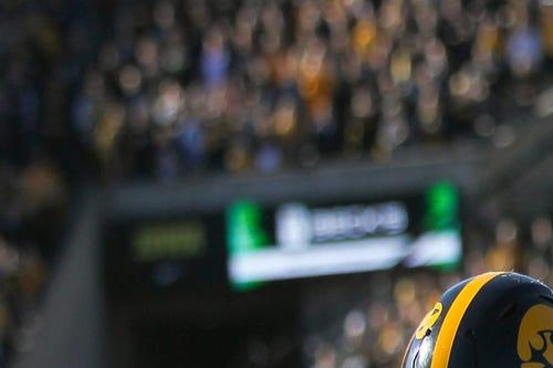 Iowa linebacker Ben Niemann tackles Wisconsin running