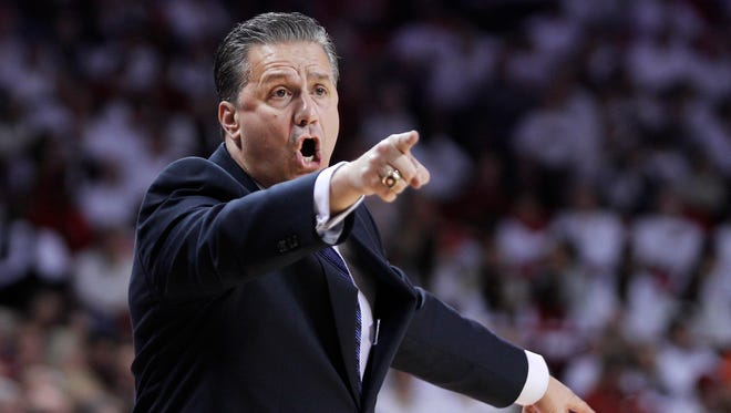 Kentucky's John Calipari yells to his players from the bench during the first half of an NCAA college basketball game against Arkansas, Thursday, Jan. 21, 2016, in Fayetteville, Ark.