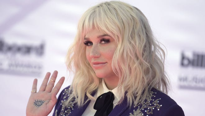 "Kesha, seen here at May's Billboard Music Awards, channeled her ""feelings of severe hopelessness and depression"" into her new song, 'Praying.'"