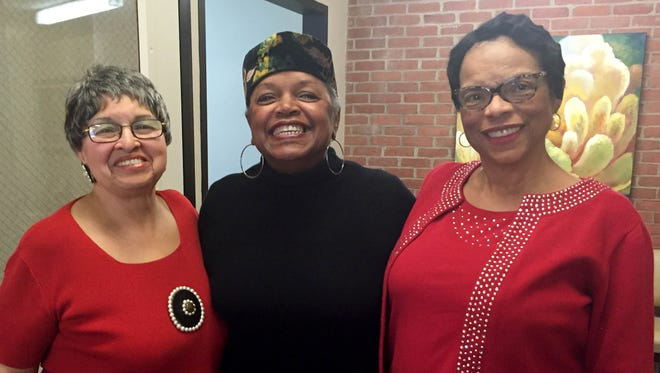 Shirley Lolles, 79, Patricia Tucker, 68, and Sharon Diane Jones, 68, participated in a project to commemorate their experiences of the 1967 Detroit riot. The picture was taken Dec. 15, 2016 at the Hannan Center for Lifelong Learning in Detroit.