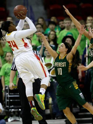 D.C. Everest High School's Taylor Petit defends against Divine Savior Holy Angels High School's Arike Ogunbowale during their WIAA Division 1 state championship basketball game Saturday, March 14, 2015, at the Resch Center.