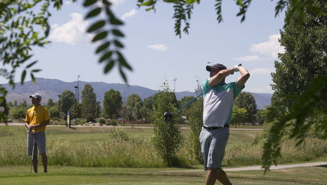 David Johnson watches his drive during the Southridge Invitational on Sunday. Johnson went on to win the tournament with a score of 140.