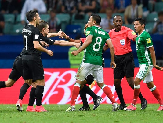 Mexico's and New Zeland's players fight during the Confederations Cup, Group A soccer match between Mexico and New Zealand, at the Fisht Stadium in Sochi, Russia, Wednesday, June 21, 2017. (AP Photo/Martin Meissner)