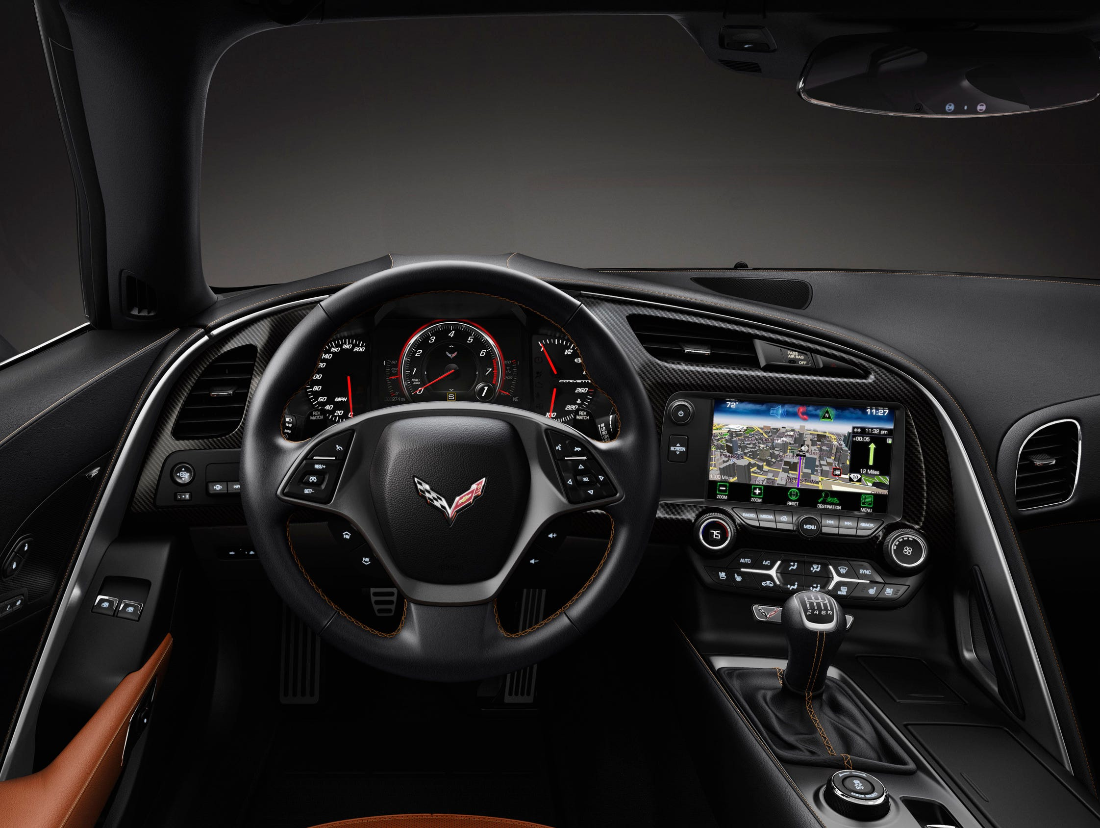 The 2014 Corvette's configurable screen dominates the instrument cluster. The cluster can be supplemented with optional head-up display.
