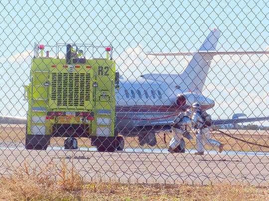 Rescue personnel at Sierra Blanca Regional Airport work to ensure the chance of fire is eliminated while injured passengers are removed from a simulated crash as part of a Federal Aviation Administration exercise Tuesday.