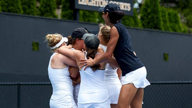 Members of the Vanderbilt women's tennis team celebrate after beating Georgia Tech on Monday to advance to the NCAA title match Tuesday.