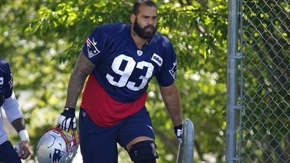 New England Patriots defensive lineman Lawrence Guy steps on the field before the start of an NFL football training camp practice, Sunday, Aug. 23, 2020, in Foxborough, Mass.