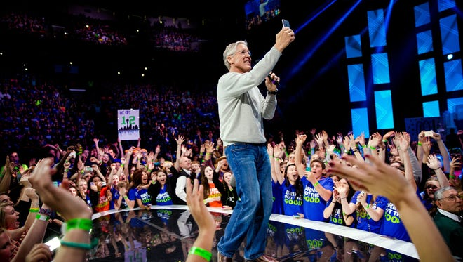 "Seattle Seahawks head coach Pete Carroll takes a selfie during the annual ""We Day"" celebration, an inspirational event and a year-long educational initiative Thursday, April 23, 2015, in Seattle."
