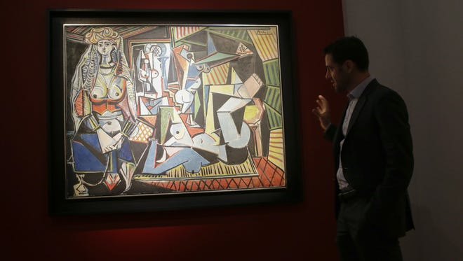 "A Christie's employee speaks about Pablo Picasso's ""Les femmes d'Alger (Version ""O""), during a media preview on May 1, at Christie's in New York."