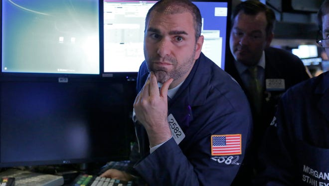 Specialist Philip Finale works on the floor of the New York Stock Exchange May 21, 2015.