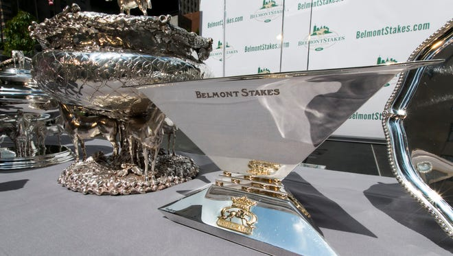 The Belmont Stakes trophy, left, and Triple Crown trophy are displayed during the post position draw for the 147th Belmont Stakes at New York's Rockefeller Center, Wednesday, June 3, 2015. American Pharoah, who drew the No. 5 post position, was made the early 3-5 favorite on Wednesday to win the Belmont Stakes and become U.S. horse racing's first Triple Crown winner in 37 years.