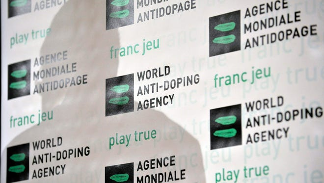 The shadow of Australian John Fahey, President of the World Anti-Doping Agency, WADA, is seen during a WADA Media Symposium at the Olympic Museum in Lausanne, Switzerland, Tuesday,  Feb. 24, 2009.
