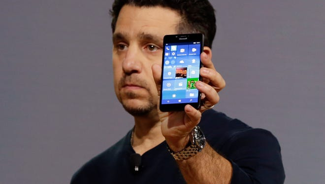 Microsoft vice president for Surface Computing Panos Panay shows a new Lumia 950 phone during a presentation.