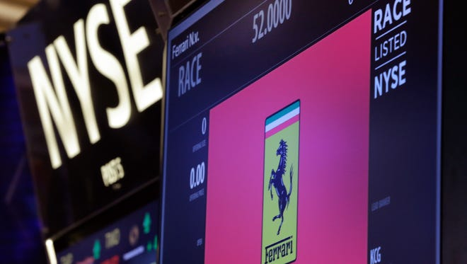 A trading post on the floor of the New York Stock Exchange is ready for Ferrari's IPO, Wednesday, Oct. 21, 2015.