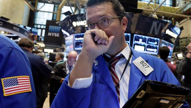 Trader Leon Montana works on the floor of the New York Stock Exchange, Monday, Aug. 3, 2015. Stocks are opening slightly lower in the U.S. as energy companies slide along with the price of crude oil.