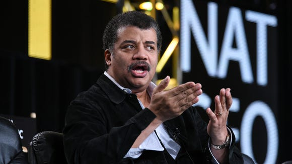 Neil deGrasse Tyson speaks on stage at the National