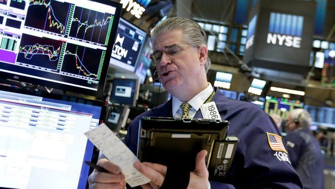 Trader Daniel Kryger works on the floor of the New York Stock Exchange, Wednesday, Feb. 24, 2016.  (AP Photo/Richard Drew)