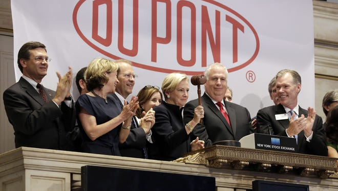 Ellen Kullman, then the chairwoman and CEO of DuPont Co., closes trading at the New York Stock Exchange on June 29. The Delaware General Assembly on Thursday approved an incentive package to keep the company in the state.