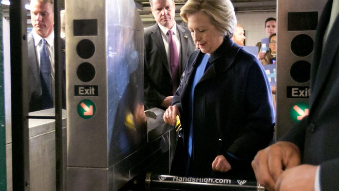 Hillary Clinton enters the subway in the Bronx, Thursday, April 7, 2016.