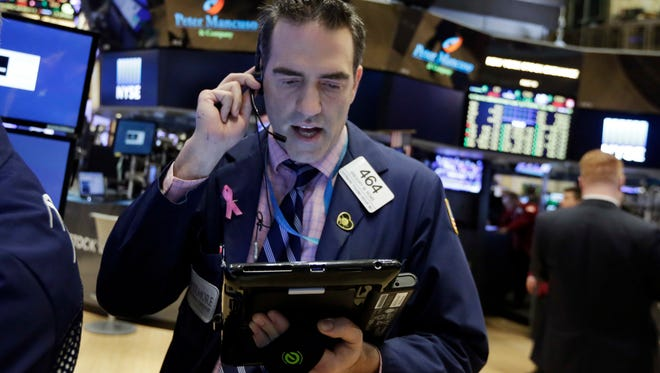 Trader Gregory Rowe works on the floor of the New York Stock Exchange, Monday, April 11, 2016.  (AP Photo/Richard Drew)
