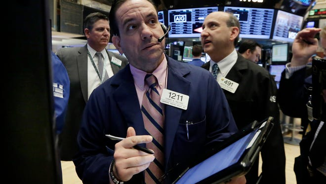 Trader Tommy Kalikas, center, works on the floor of the New York Stock Exchange, Thursday, May 12, 2016.  (AP Photo/Richard Drew)