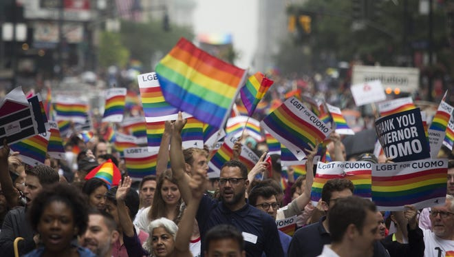 People walk along Fifth Avenue during the annual 2015 New York City Pride March in Manhattan, New York City, N.Y.