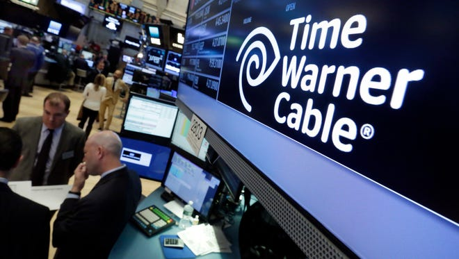 File photo taken in 2016 shows the Time Warner Cable logo above the post where it trades on the floor of the New York Stock Exchange.