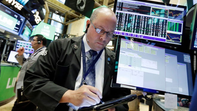 Trader Jeffrey Vazquez works on the floor of the New York Stock Exchange, Thursday, July 14, 2016. (AP Photo/Richard Drew)