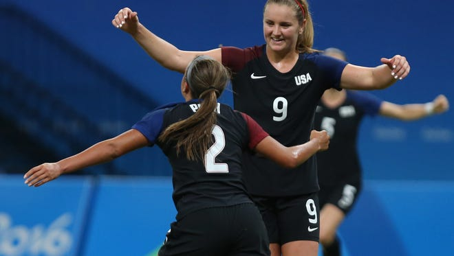 United States' Mallory Pugh, left, is congratulated after scoring her side's second goal by teammate Lindsey Horan during a Group G match of the women's Olympic football tournament between Colombia and United States. The U.S. and Colombia played to 2-2 draw Tuesday at the Arena Amazonia stadium in Manaus, Brazil.