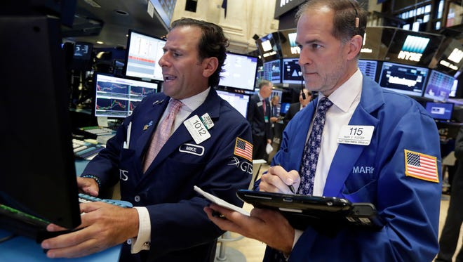 Specialist Michael Pistillo, left, and trader Mark Puetzer work on the floor of the New York Stock Exchange, Tuesday, Sept. 6, 2016. (AP Photo/Richard Drew)