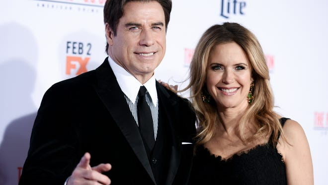 """John Travolta, left, and Kelly Preston attend the LA Premiere of """"'American Crime Story: The People v. O.J. Simpson"""" held at Westwood Village Theatre on Wednesday, Jan. 27, 2016, in Los Angeles."""