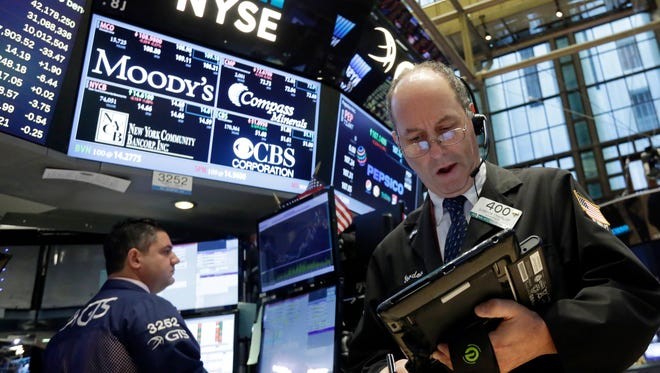 Trader Gordon Charlop, right, works on the floor of the New York Stock Exchange, Monday, Sept. 26, 2016. (AP Photo/Richard Drew)