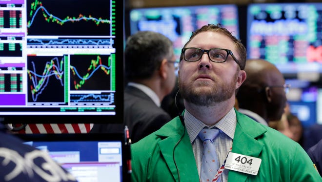 Trader Ryan Falvey works on the floor of the New York Stock Exchange on Oct. 17, 2016.