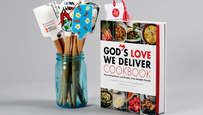 "This photo shows the No Kid Hungry Chef Series Silicone Spatulas and the ""God's Love We Deliver's Cookbook: Nourishing Stories and Recipes from Notable Friends,"" Thursday, Sept. 29, 2016, in New York. Proceeds from the sale of the book and spatulas go to charity."