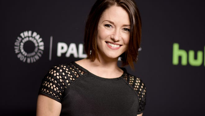 "Chyler Leigh, who plays Alex Danvers in ""Supergirl,""  attends the 33rd Annual Paleyfest: ""Supergirl"" held at the Dolby Theatre on Sunday, March 13, 2016, in Los Angeles. (Photo by Richard Shotwell/Invision/AP)"