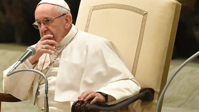 Pope Francis looks on during a general audience at the Vatican on February 8, 2017.