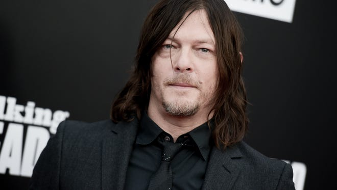"""Norman Reedus attends the Live Special Edition of """"Talking Dead"""" at the Hollywood Forever Cemetery on Sunday, Oct. 23, 2016, in Los Angeles. (Photo by Richard Shotwell/Invision/AP)"""