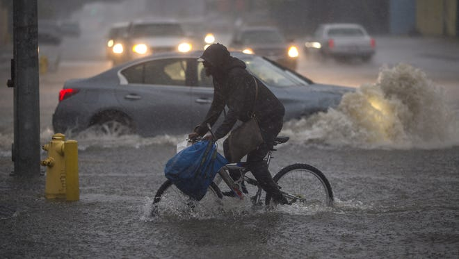 A bicyclist rides along a flooded street as a powerful storm moves across Southern California on Feb. 17, 2017 in Sun Valley, Calif.. After years of severe drought, heavy winter rains have come to the state, and with them, the issuance of flash flood watches in Santa Barbara, Ventura and Los Angeles counties, and the evacuation of hundreds of residents from Duarte, Calif. for fear of flash flooding from areas denuded by a wildfire last year.