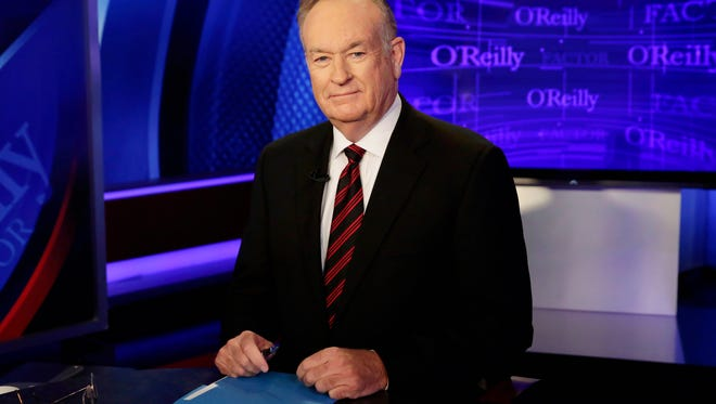 """FILE - In this Oct. 1, 2015 file photo, host Bill O'Reilly of """"The O'Reilly Factor"""" on the Fox News Channel, poses for photos in the set in New York.  More advertisers have joined the list of defectors from Fox's The O'Reilly Factor show bringing the total to around 20.  The New York Times had revealed over the weekend that Fox News' parent company had paid settlements totaling $13 million to five women to keep quiet about alleged mistreatment at the hands of Fox's prime-time star. O'Reilly has denied wrongdoing and said he supported the settlements so his family wouldn't be hurt. The news has sparked an exodus of advertisers telling Fox they didn't want to be involved in O'Reilly's show.  (AP Photo/Richard Drew, File)"""