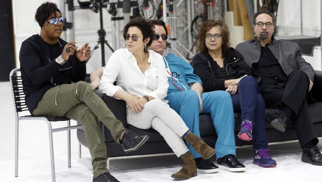 Bassist BrownMark, left, answers a question as the original members of Prince's 1980's band, The Revolution, from second left, guitarist Wendy Melvoin, keyboarders Matt Fink and Lisa Coleman and drummer Bobby Z, look on during an interview, Wednesday, April 19, 2017, in Minneapolis. The group is preparing to kick off a spring U.S. tour with a performance Friday, the first anniversary of the Prince's death from an accidental overdose.