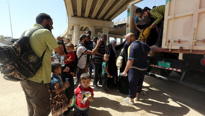 Iraqi displaced people arrive to the positions of Iraqi forces in western Mosul on  May 30, 2017.