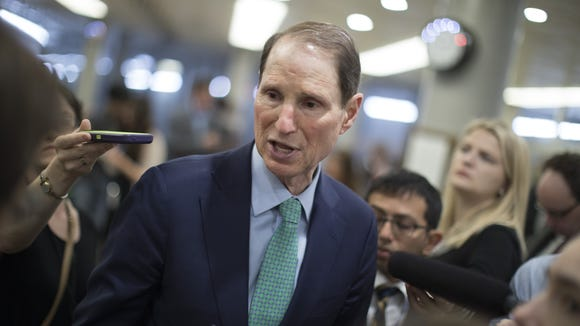 Sen. Ron Wyden speaks to reporters on Capitol Hill on May 2, 2017.